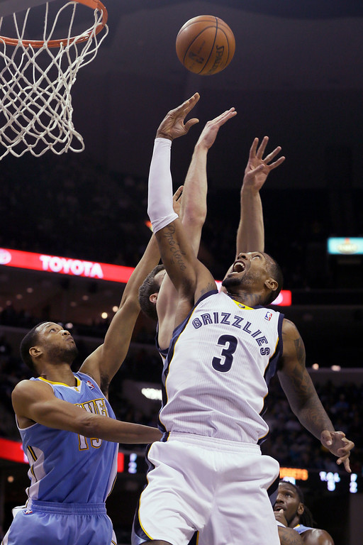 . Denver Nuggets\' Anthony Randolph, left, and Memphis Grizzlies\' James Johnson (3) and Jon Leuer, center, go up for a rebound during the first half of an NBA basketball game in Memphis, Tenn., Saturday, Dec. 28, 2013. (AP Photo/Danny Johnston)