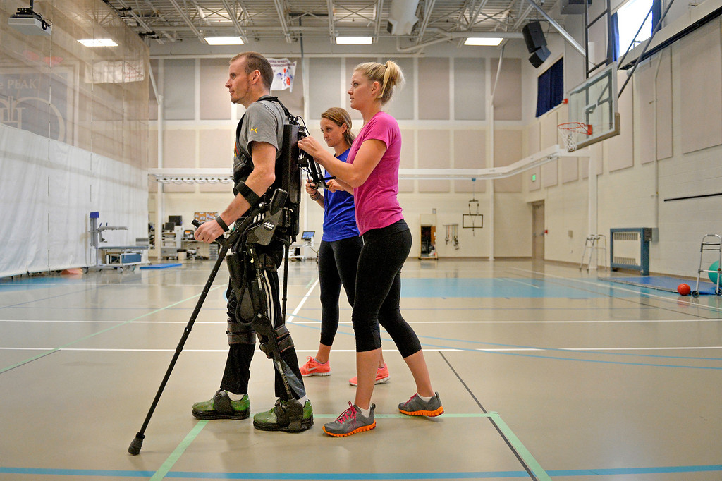 ". An exoskeleton senses a patient\'s intentions by leaning, then helps complete the step. James stood for more than 40 minutes and took 819 steps. ""As they get smaller and more affordable, I\'d like to see them get into the civilian population and offer that freedom.\"" (Photo By Craig F. Walker / The Denver Post)"