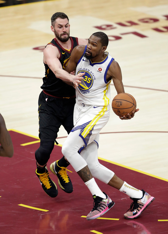 . Golden State Warriors\' Kevin Durant goes to the basket against Cleveland Cavaliers\' Kevin Love in the first half of Game 3 of basketball\'s NBA Finals, Wednesday, June 6, 2018, in Cleveland. (AP Photo/Tony Dejak)