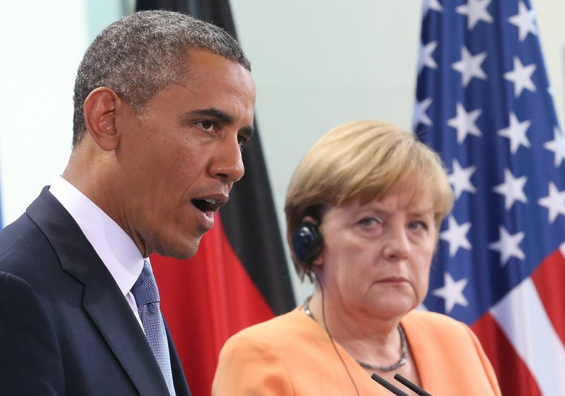 """. <p><b> National Security Agency officials are claiming that President Obama knows nothing about � </b> <p> A. Phone surveillance of German Chancellor Angela Merkel <p> B. Spying on most foreign heads of state <p> C. Anything <p><b><a href=\'http://www.theguardian.com/world/2013/oct/27/barack-obama-nsa-angela-merkel-germany\' target=\""""_blank\"""">HUH?</a></b> <p>  (AP Photo/dpa, Michael Kappeler,File)"""