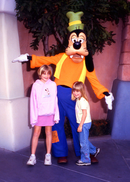 Emily and Elena with Goofy.