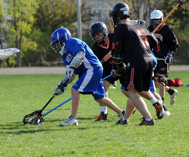Action from Lewiston Middle School vs Brunswick lacrosse game on 4/24/12.  Brunswick wins 3-2 in the third overtime