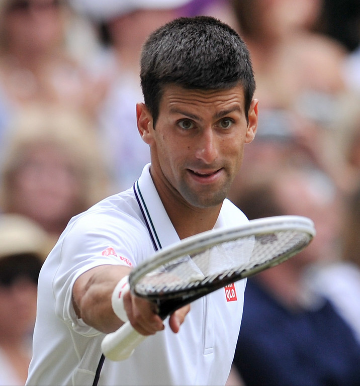 . Serbia\'s Novak Djokovic gestures during his men\'s singles final match against Switzerland\'s Roger Federer on day thirteen of  the 2014 Wimbledon Championships at The All England Tennis Club in Wimbledon, southwest London, on July 6, 2014.  GLYN KIRK/AFP/Getty Images
