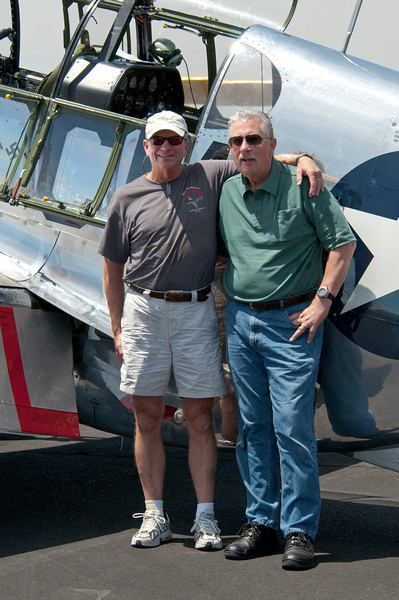 Pictured after the flight are Gary and John R. (Bob) Blankenship, Collins Foundation P-51 pilot and captain with Southwest Airlines.