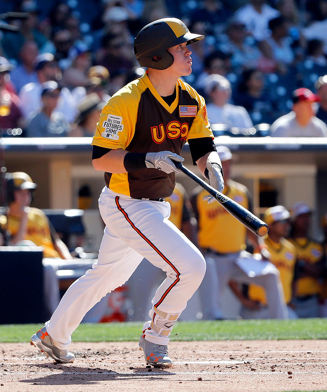 . U.S. Team\'s Chance Sisco, of the Baltimore Orioles, follows through during the second inning of the All-Star Futures baseball game against the World Team, Sunday, July 10, 2016, in San Diego. (AP Photo/Lenny Ignelzi)