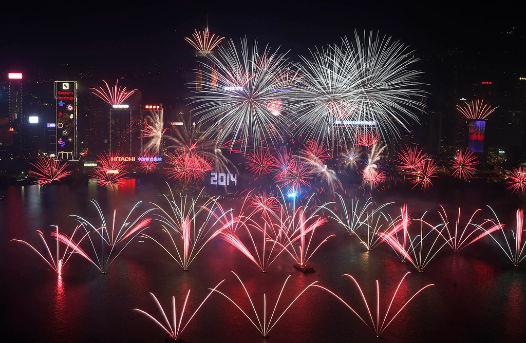 . Fireworks explode at the Hong Kong Convention and Exhibition Centre over the Victoria Harbor during New Year\'s Eve to celebrate the start of 2014 in Hong Kong, Wednesday, Jan. 1, 2014 (AP Photo/Kin Cheung)
