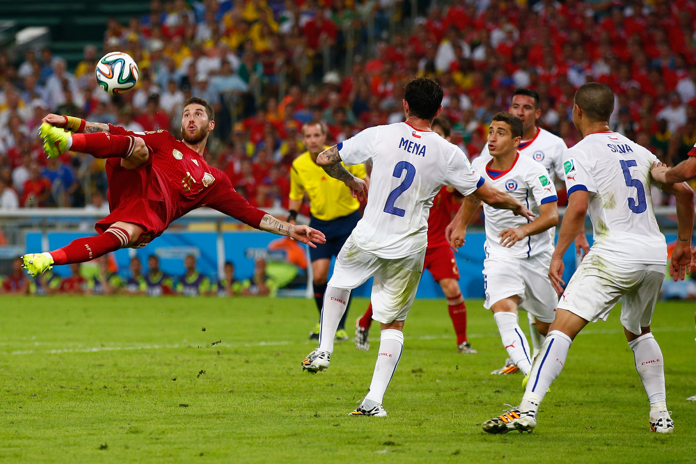 . Sergio Ramos of Spain performs an overhead kick during the 2014 FIFA World Cup Brazil Group B match between Spain and Chile at Maracana on June 18, 2014 in Rio de Janeiro, Brazil.  (Photo by Clive Rose/Getty Images)