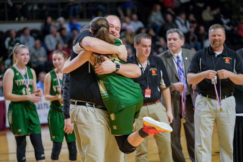 Oxford Hills' Nate Pelletier hugs Cassidy Dumont during the presentation of the Gold Ball.