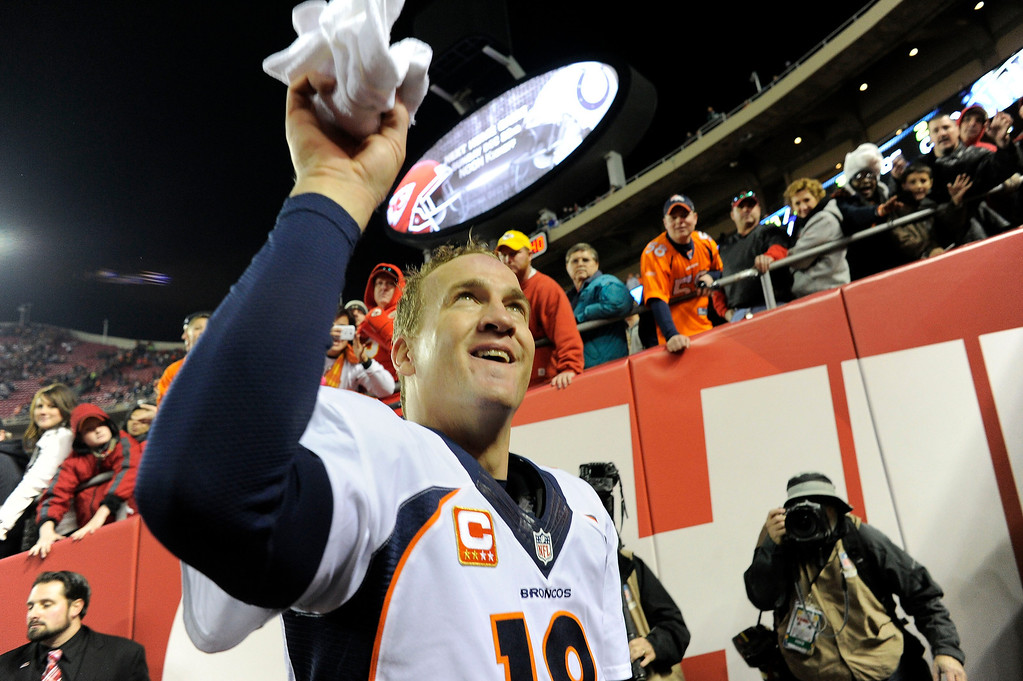 . Denver Broncos quarterback Peyton Manning (18) tosses up his towel in the tunnel after the Broncos\' win over the Kansas City Chiefs 35-28 on December 1, 2013 at Arrowhead Stadium.  (Photo by John Leyba/The Denver Post)