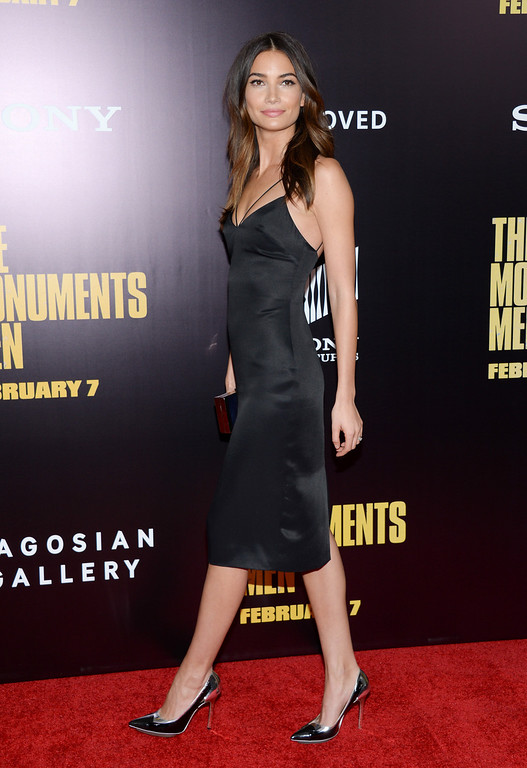 ". Model Lily Aldridge attends the premiere of ""The Monuments Men\"" at the Ziegfeld Theatre on Tuesday, Feb. 4, 2014, in New York.  (Photo by Evan Agostini/Invision/AP)"