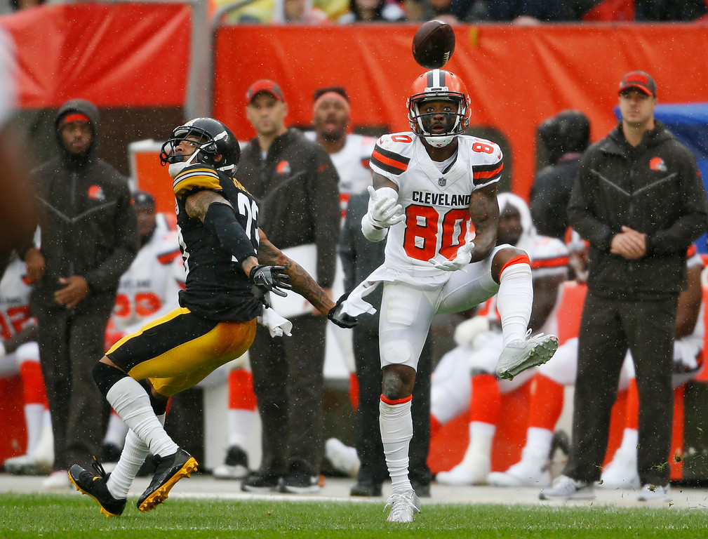 . Cleveland Browns wide receiver Jarvis Landry (80) catches a pass against Pittsburgh Steelers defensive back Joe Haden (23) during the first half of an NFL football game, Sunday, Sept. 9, 2018, in Cleveland. (AP Photo/Ron Schwane)