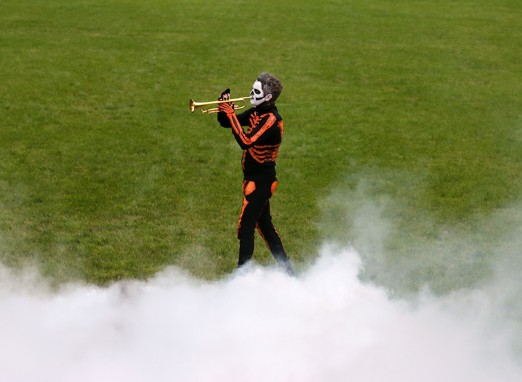 . WASHINGTON, DC - OCTOBER 31: Simulated smoke fills the air as a musician in costume plays the Trumpet while U.S. President Barack Obama, first lady Michelle Obama give out treats to children on the South Lawn of the White House, October 31, 2013 in Washington, DC. President Obama and First Lady Michelle Obama welcomed local children and children of military families to trick-or-treat for Halloween. (Photo by Mark Wilson/Getty Images)