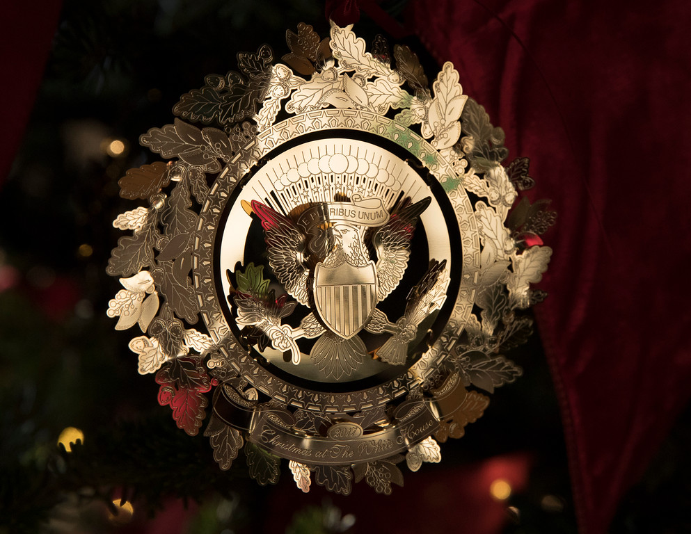 . The First Family\'s official Christmas ornament is seen on a tree in the East Garden Room during a media preview of the 2017 holiday decorations at the White House in Washington, Monday, Nov. 27, 2017. (AP Photo/Carolyn Kaster)