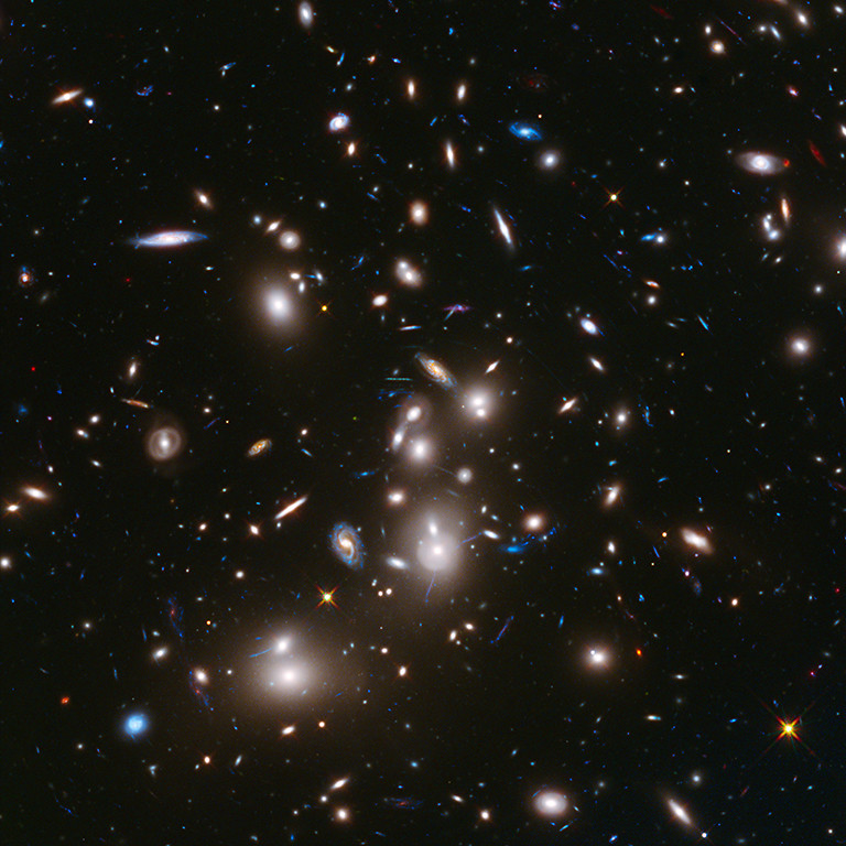. 2014: Frontier Field Abell 2744 This long-exposure Hubble Space Telescope image of massive galaxy cluster Abell 2744 is the deepest ever made of any cluster of galaxies. It shows some of the faintest and youngest galaxies ever detected in space. Abell 2744, located in the constellation Sculptor, appears in the foreground of this image. It contains several hundred galaxies as they looked 3.5 billion years ago. The immense gravity in Abell 2744 acts as a gravitational lens to warp space and brighten and magnify images of nearly 3,000 distant background galaxies. The more distant galaxies appear as they did longer than 12 billion years ago, not long after the big bang. This image is part of an unprecedented long-distance view of the universe from an ambitious collaborative project among the NASA Great Observatories called The Frontier Fields. Over the next several years select patches of the sky will be photographed for the purpose of better understanding galaxy evolution. This visible-light and near-infrared composite image was taken with the Wide Field Camera 3.  Credit: NASA, ESA, and J. Lotz, M. Mountain, A. Koekemoer, and the HFF Team (STScI)