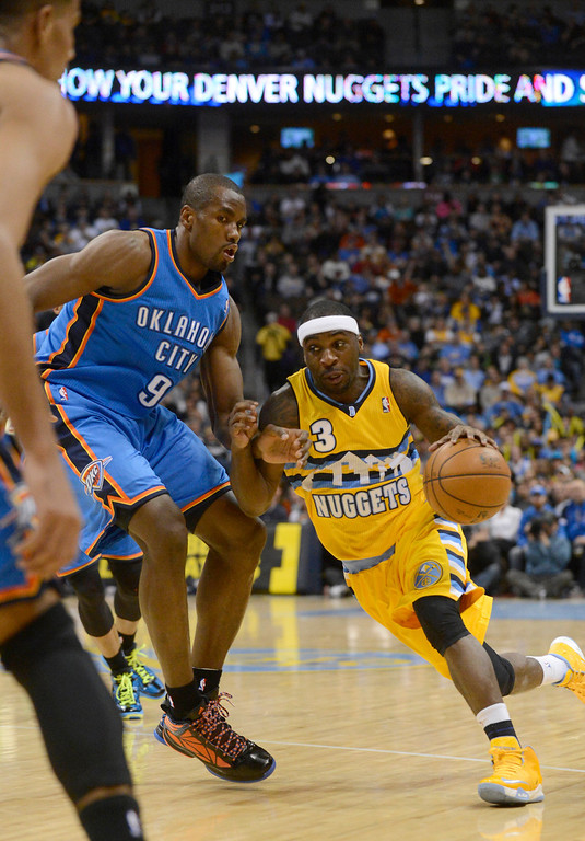 . DENVER, CO. - JANUARY 20: Denver Nuggets point guard Ty Lawson (3) drives on Oklahoma City Thunder power forward Serge Ibaka (9) during the first quarter January 20,  2013 at Pepsi Center. (Photo By John Leyba / The Denver Post)