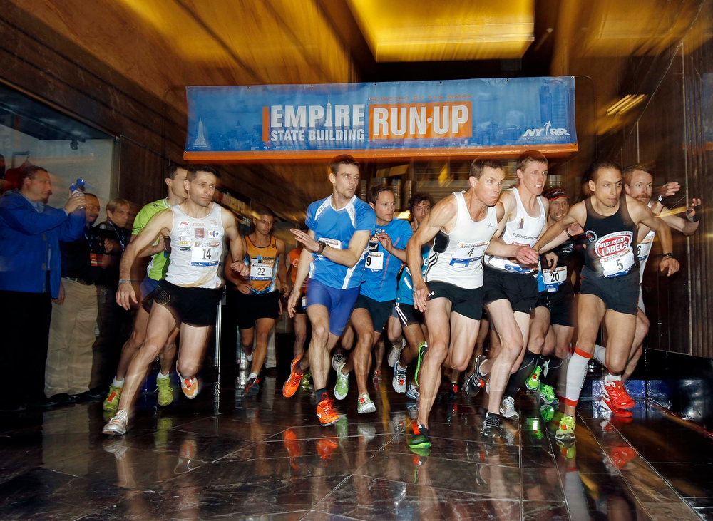 . The men\'s invitational runners participate during the start of the 36th Empire State Building Run-Up running race in New York, February 6, 2013. Competitors run up 1,576 steps and 1,050 feet in a stairwell from the ground floor to the 86th floor observation deck.   REUTERS/Adam Hunger