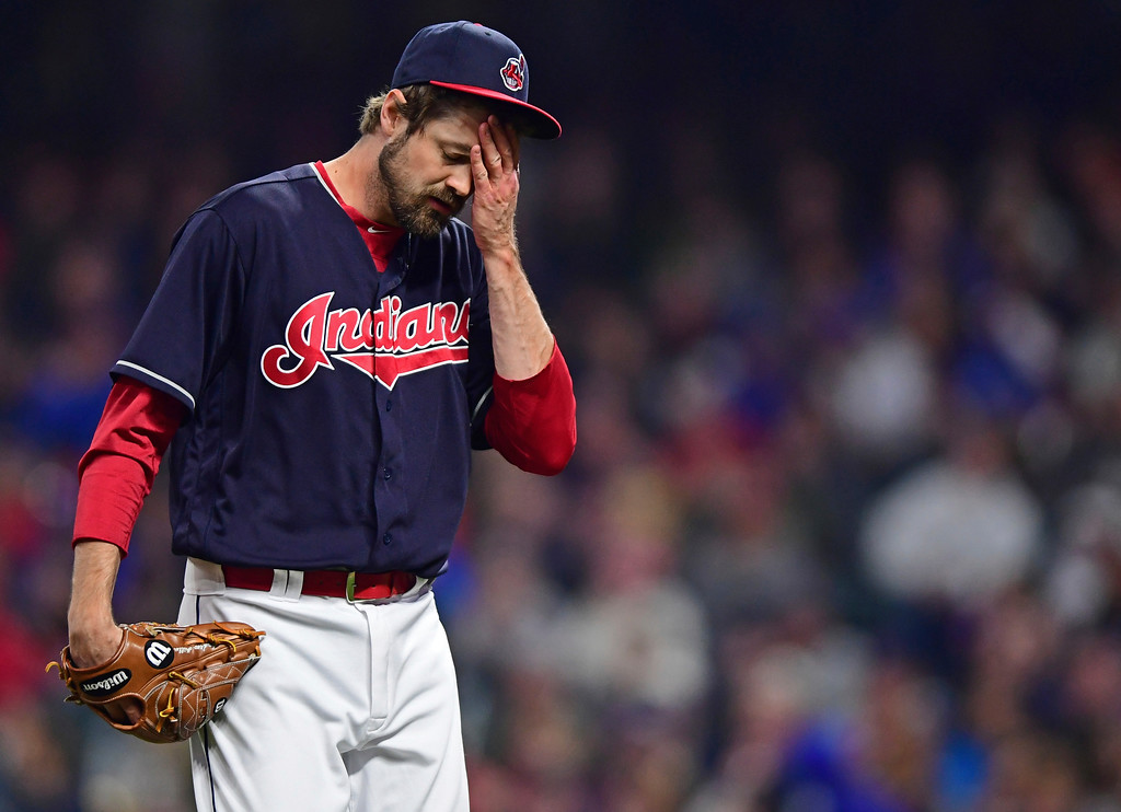 . Cleveland Indians relief pitcher Andrew Miller walks to the dugout during the seventh inning of the team\'s baseball game against the Toronto Blue Jays, Friday, April 13, 2018, in Cleveland. The Blue Jays won 8-4. (AP Photo/David Dermer)