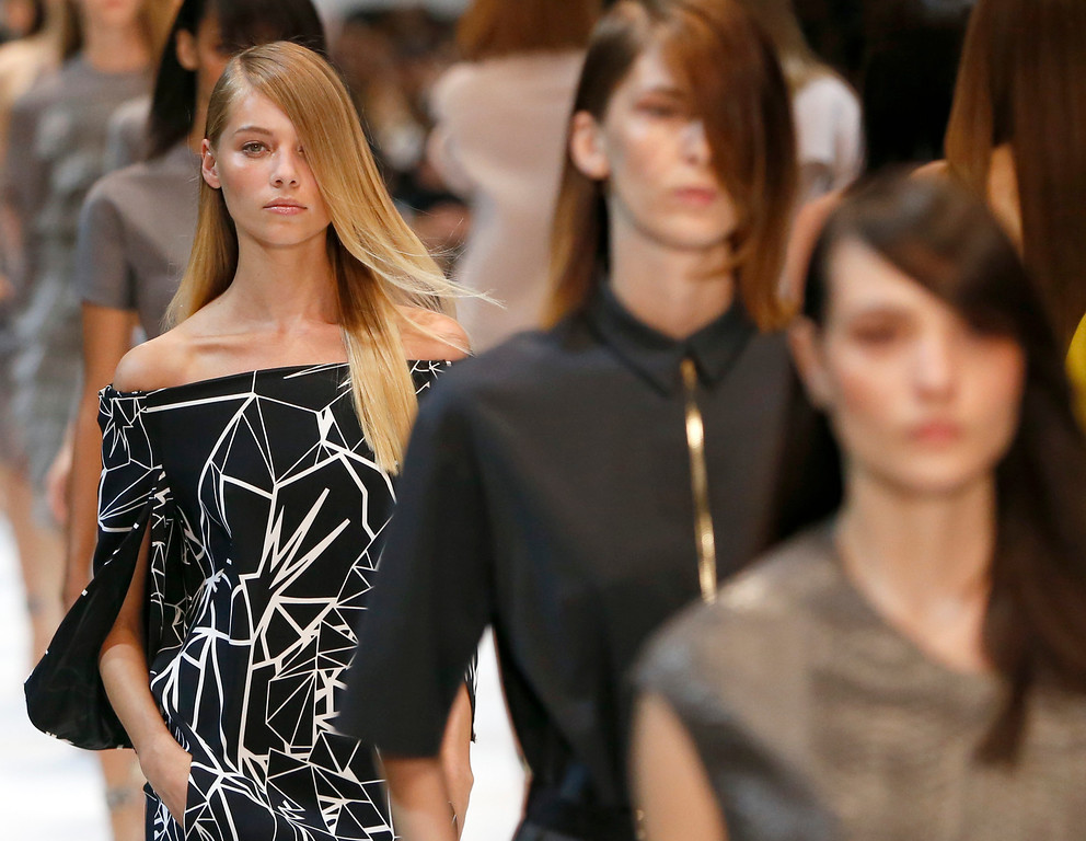 . A model wears a creation for Guy Laroche\'s ready-to-wear Spring/Summer 2014 fashion collection, in Paris, Wednesday, Sept.25, 2013. (AP Photo/Jacques Brinon)