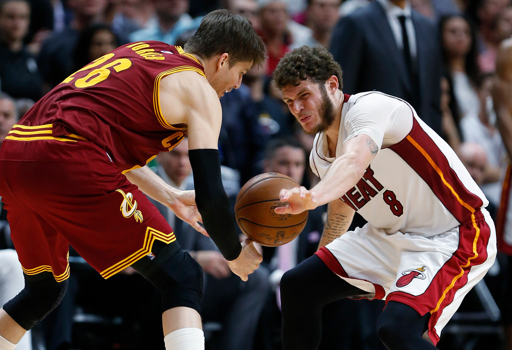. Miami Heat guard Tyler Johnson (8) steals the ball from Cleveland Cavaliers guard Kyle Korver (26) during overtime in an NBA basketball game, Monday, April 10, 2017, in Miami. The Heat defeated the Cavaliers 124-121 in overtime. (AP Photo/Wilfredo Lee)