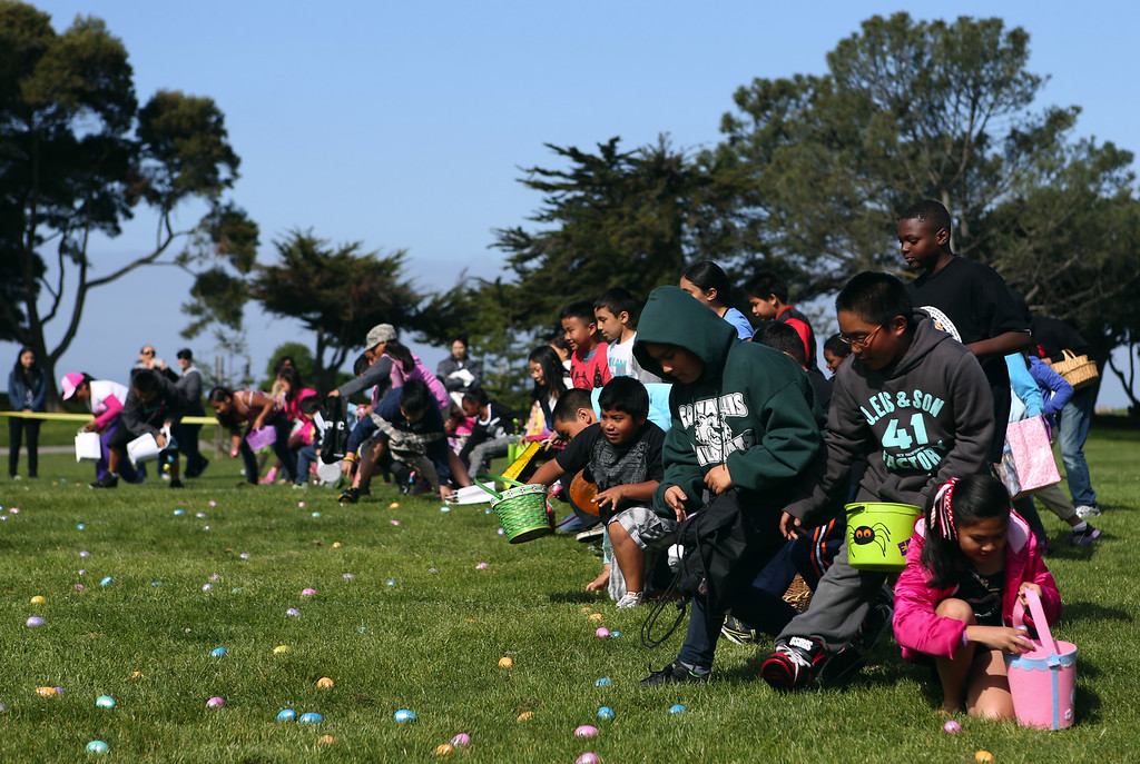 . Kids race to snatch up plastic Easter eggs at the annual San Leandro hunt held at Marina Park in San Leandro, Calif., Saturday, April 12, 2014. The event has been held every year since 1951 and this year is sponsored by the San Leandro Optimist Club. 8,000 eggs with a candy or sticker surprise were given away. (Anda Chu/Bay Area News Group)