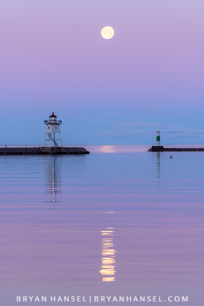 The Full Strawberry Moon Sets over the Grand Marais Harbor