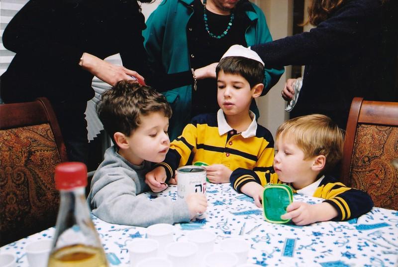 2002-12-06 Hanukkah Tzedakah boxes- Noah, Josh, Adam.jpg