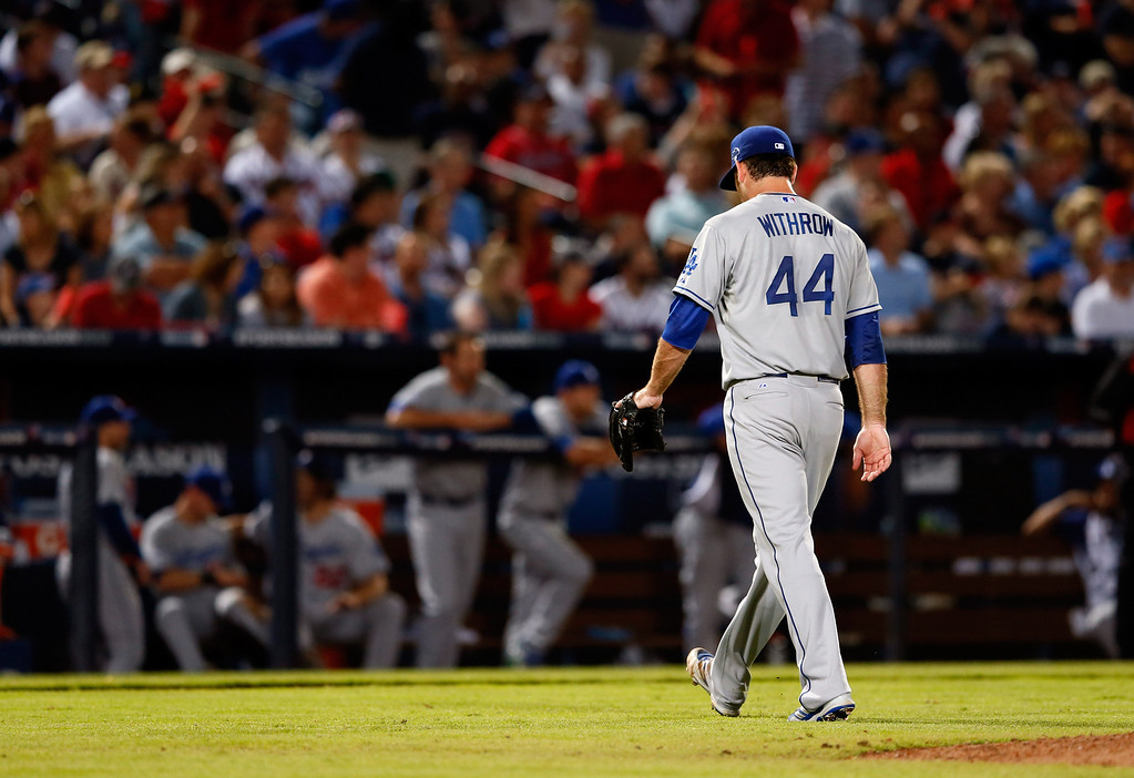 . ATLANTA, GA - OCTOBER 04: Chris Withrow #44 of the Los Angeles Dodgers walks to the dugout after being relieved in the seventh inning against the Atlanta Braves during Game Two of the National League Division Series at Turner Field on October 4, 2013 in Atlanta, Georgia.  (Photo by Kevin C. Cox/Getty Images)