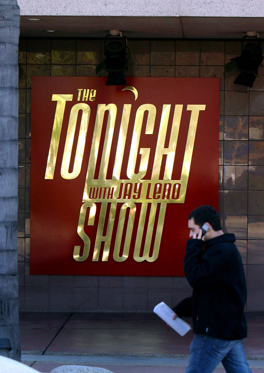 """. A man walks by the NBC studios, in Burbank, Calif., where \""""The Tonight Show Starring Johnny Carson,\"""" was taped, Sunday, Jan. 23, 2005. Carson, the quick-witted \""""Tonight Show\"""" host who became a national institution putting his viewers to bed for 30 years with a smooth nightcap of celebrity banter and heartland charm, died Sunday. He was 79. \""""The Tonight Show with Jay Leno\"""" has since taken over.   (AP Photo/Stefano Paltera)"""