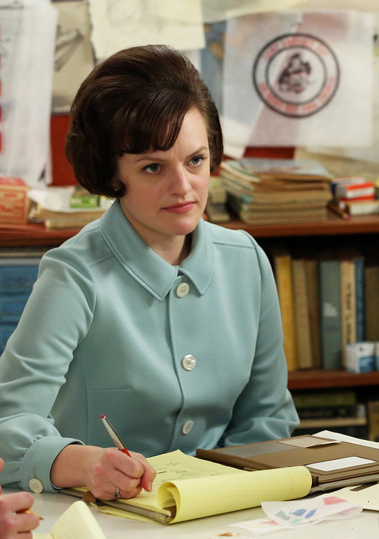 ". This TV publicity image released by AMC shows  Elisabeth Moss as Peggy Olson in a scene from ""Mad Men.\"" The season finale airs Sunday, June 23, on AMC. Olson was nominated for an Emmy Award for best actress in a drama series on Thursday July 18, 2013. The Academy of Television Arts & Sciences\' Emmy ceremony will be hosted by Neil Patrick Harris. It will air Sept. 22 on CBS. (AP Photo/AMC, Michael Yarish)"
