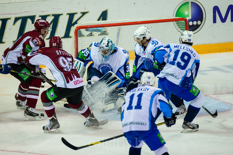 Goaltender of Dinamo Minsk Kevin Lalande (35) saves the goal