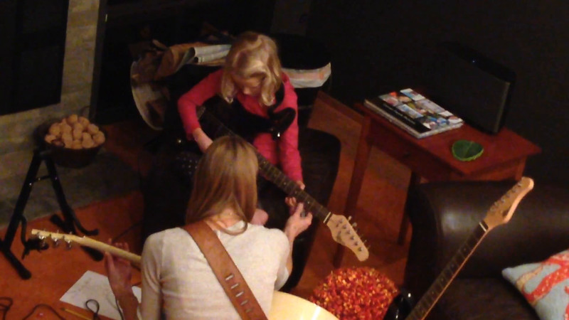 "Video of Amelia's first guitar lesson. Playing and singing the ""Colorful Bunny Friends"" theme song the day before."
