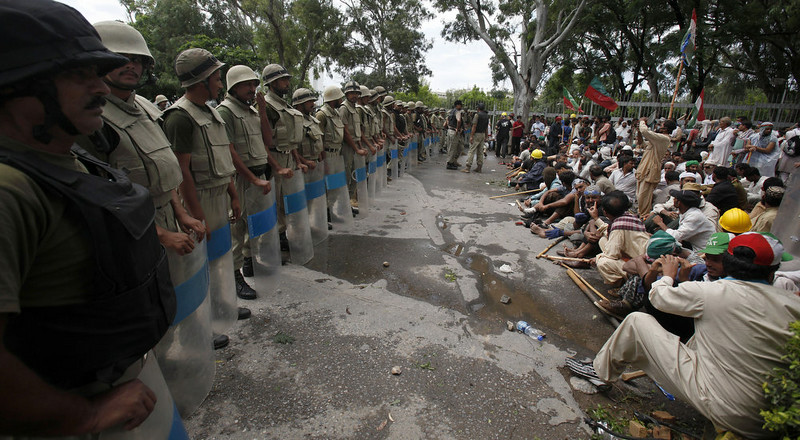 . Pakistani troops stand guard as supporters of anti-government Muslim cleric Tahir-ul-Qadri stage a sit in protest close to Prime Minister\'s home in Islamabad, Pakistan on Monday, Sept. 1, 2014. Anti-government protesters and Pakistani police have clashed once again as the demonstrators pushed into a sprawling government complex in the country\'s capital in an effort to try to reach the prime minister\'s official residence. (AP Photo/Anjum Naveed)