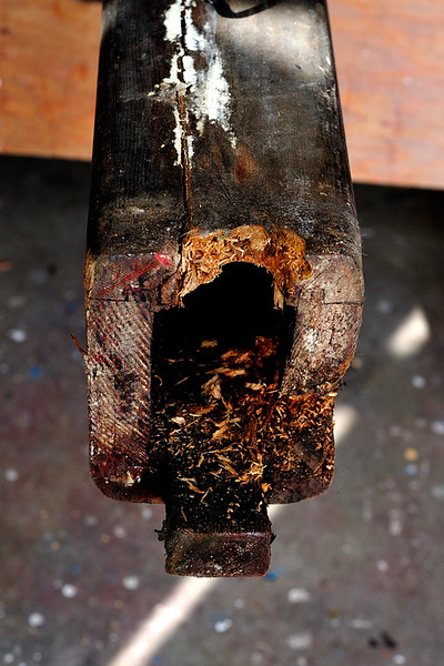 Much rot was found at the base of the mast. It must be cut out, and new wood put in. Photo Credit: Chris Van Der Schyf