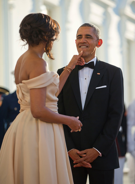 . First lady Michelle Obama touches President Barack Obama\'s chin as they wait for the arrival of Nordic Leaders on the North Portico for a State Dinner at the White House in Washington, Friday, May 13, 2016. (AP Photo/Pablo Martinez Monsivais)