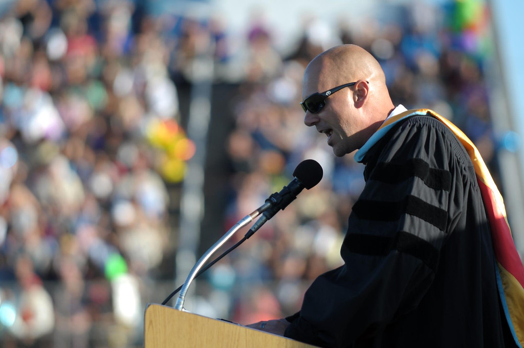 . Principal Dr. Matthew Horvath addresses his students. The 2013 North High School commencement ceremonies take place on the school\'s football field in Torrance Wednesday afternoon.