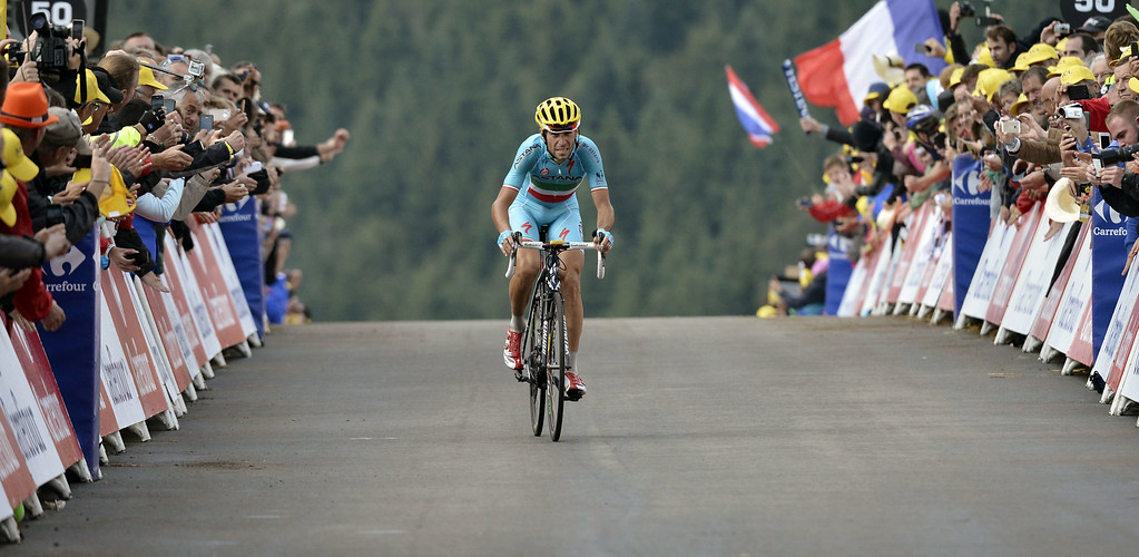 . Italy\'s Vincenzo Nibali celebrates as he crosses the finish line at the end of the 161.50 km tenth stage of the 101st edition of the Tour de France cycling race on July 14, 2014 between Mulhouse and La Planche des Belles Filles ski resort, eastern France.  AFP PHOTO / JEFF PACHOUD/AFP/Getty Images