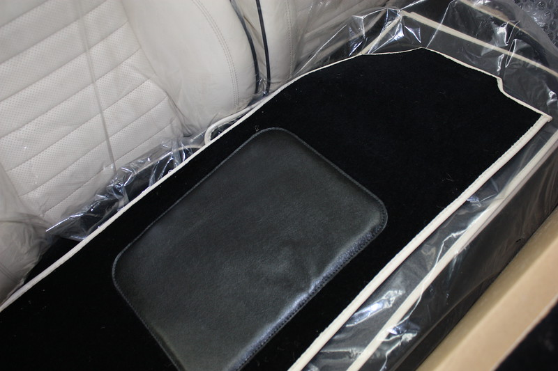 Black wool carpet with cream leather edging