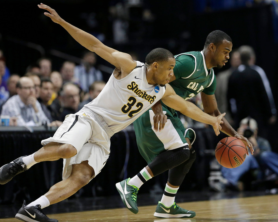 . Wichita State guard Tekele Cotton (32) goes for the steal against Cal Poly guard Maliik Love (3) go after the ball during the first half of a second-round game in the NCAA college basketball tournament Friday, March 21, 2014, in St. Louis. (AP Photo/Charlie Riedel)