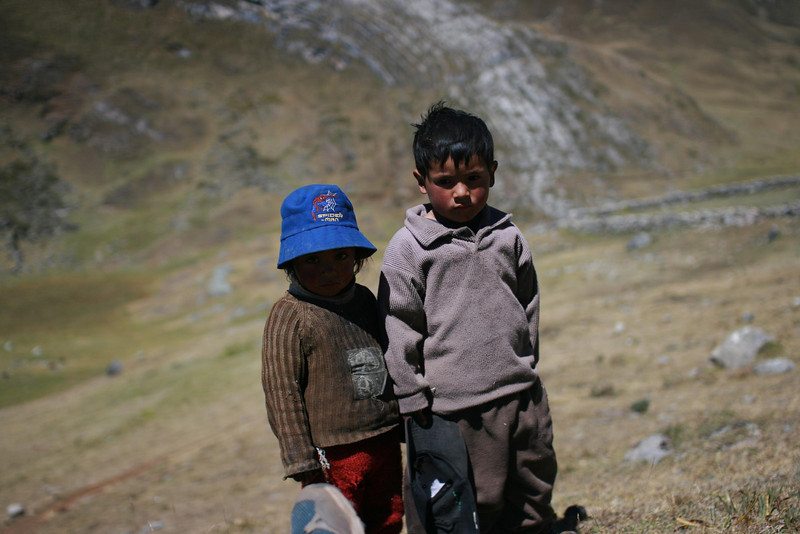 Curious children.: Their cheeks are flushed from living at high altitude.