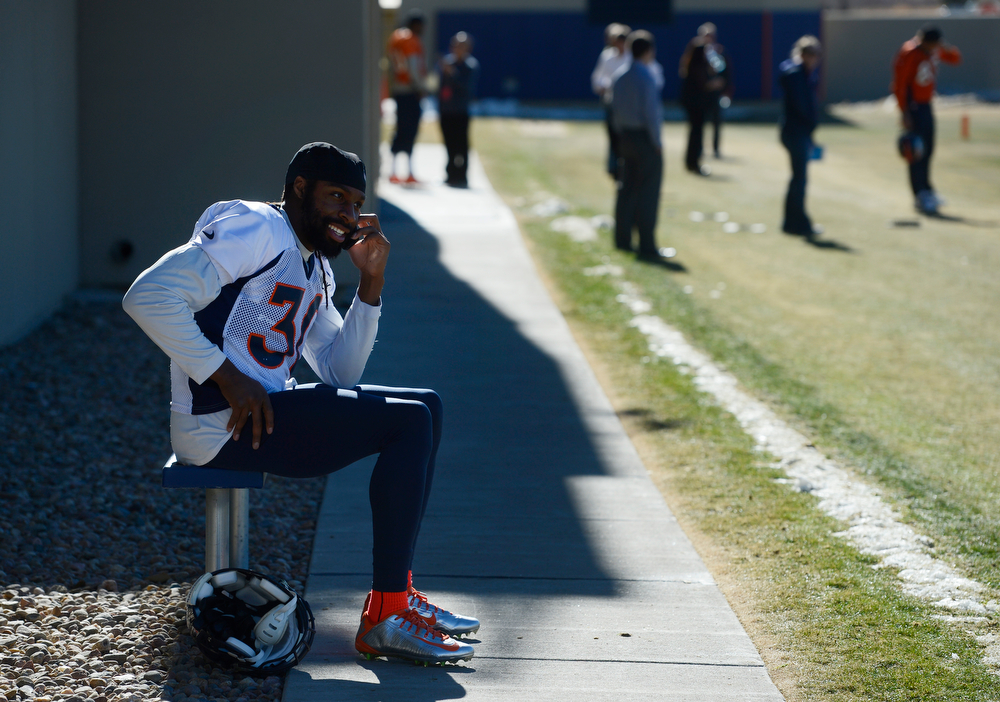 . Denver Broncos safety, David Bruton, makes a phone call after practice at Dove Valley Saturday morning, January 25, 2014. (Photo By Andy Cross / The Denver Post)