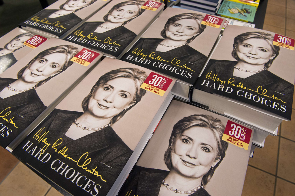 ". Copies of former US Secretary of State Hillary Clinton\'s new book, ""Hard Choices\"" are viewed for sale at the Barnes & Noble Booksellers store June 10, 2014, in Fairfax, Virginia. AFP PHOTO/Paul J. RICHARDS/AFP/Getty Images"
