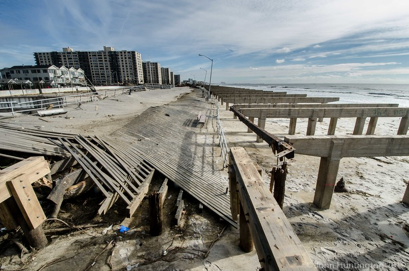 QUEENS, NY/USA - NOVEMBER 1, 2012: A section of the Rockaway Beach boardwalk is seen displaced from its foundations by hurricane Sandy.
