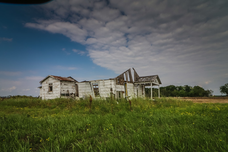 House Falling Apart in a Field