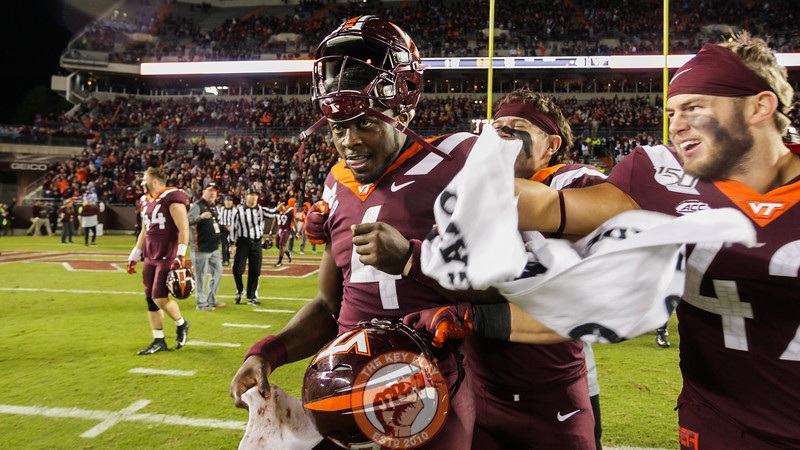 QB Quincy Patterson walks off the field as the Hokies celebrate their 6OT win over UNC. (Mark Umansky/TheKeyPlay.com)