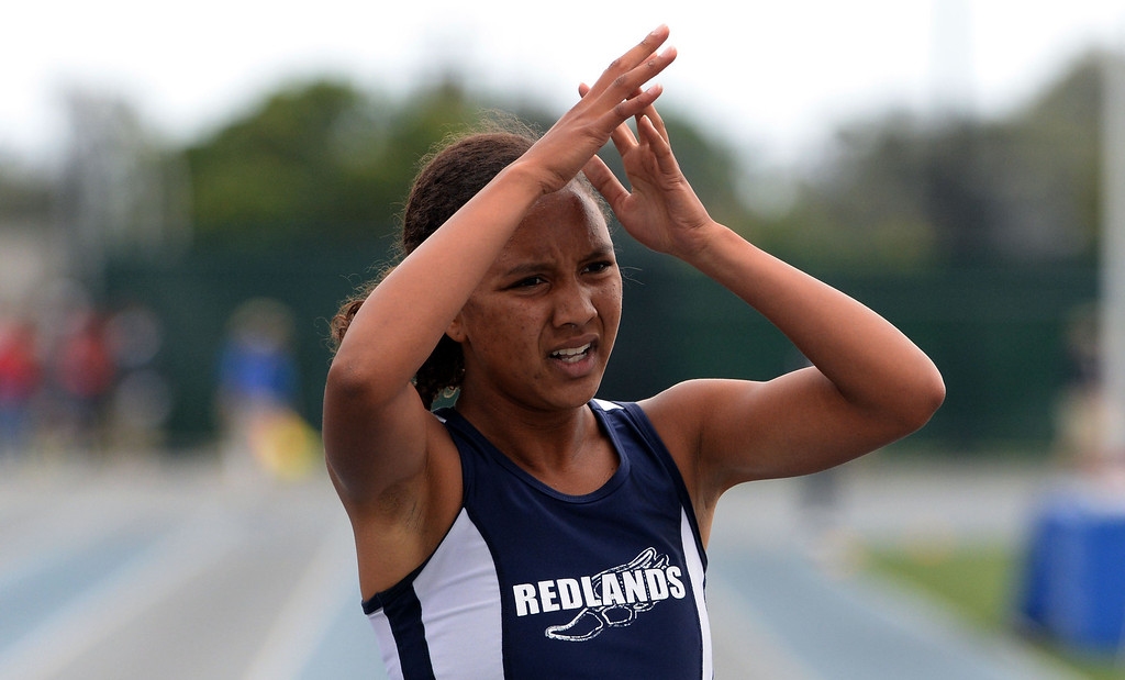 . Redland\'s Margaux Jones finishes second in the division 2 200 meters race during the CIF Southern Section track and final Championships at Cerritos College in Norwalk, Calif., Saturday, May 24, 2014.   (Keith Birmingham/Pasadena Star-News)