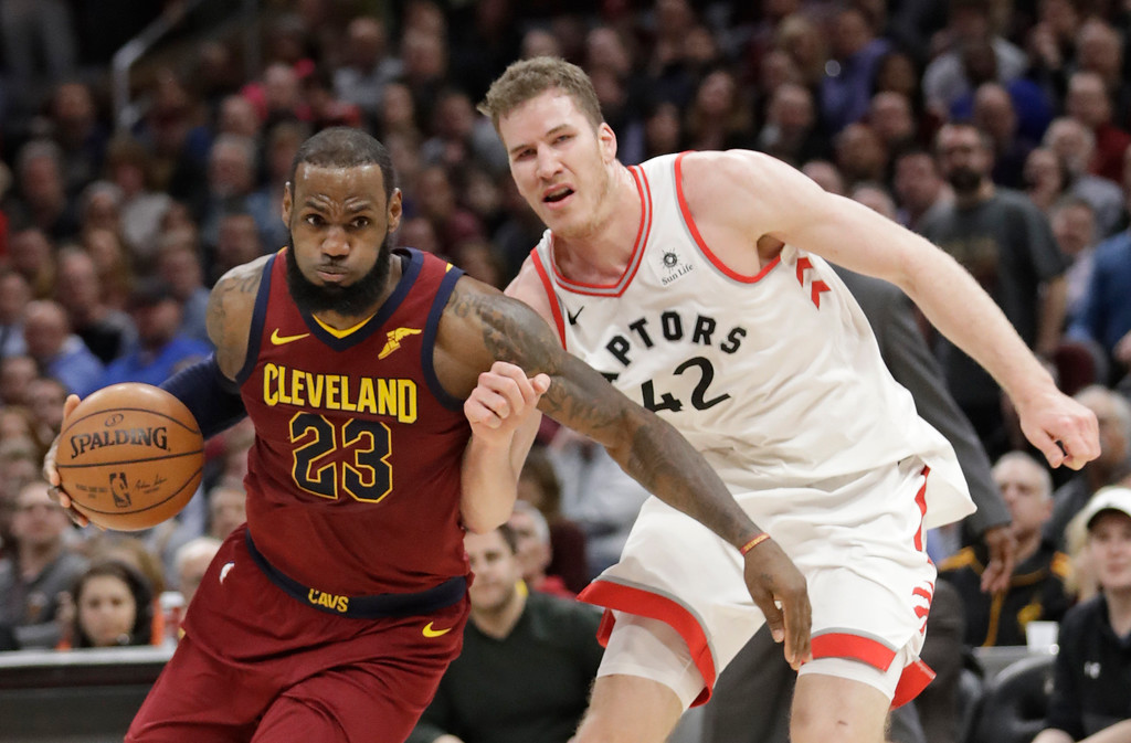 . Cleveland Cavaliers\' LeBron James (23) drives past Toronto Raptors\' Jakob Poeltl (42) during the second half of an NBA basketball game Wednesday, March 21, 2018, in Cleveland. The Cavaliers won 132-129. (AP Photo/Tony Dejak)