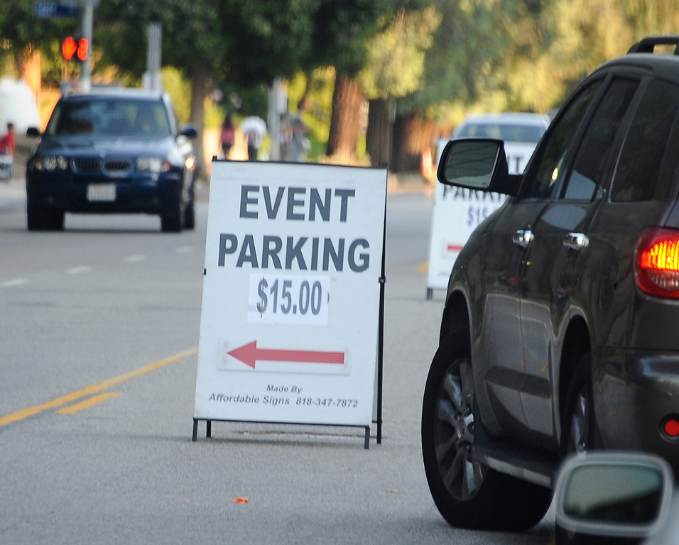 . July 4,2013 Woodland Hills. Parking close to the park was going to cost you 15.00 dollars during the July Fourth Fireworks Extravaganza: Keyes Automotive Group co-sponsors the event with music by the Los Angeles Pierce Symphonic who performed  Photo by Gene Blevins/LA Daily News