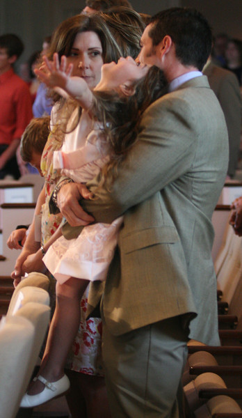 A young member worships with her father during Easter services at Western Avenue Baptist Church in Statesville, NC.