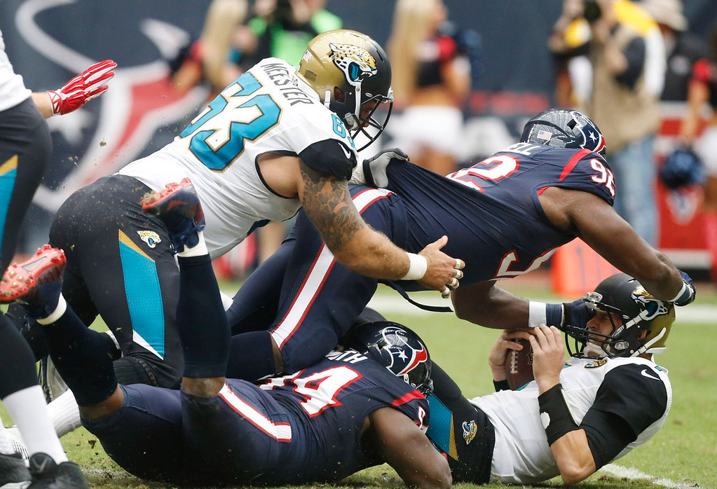 . Jacksonville Jaguars quarterback Chad Henne gets sacked by Houston Texans nose tackle Earl Mitchell (92) during the first quarter an NFL football game Sunday, Nov. 24, 2013, in Houston. (AP Photo/Patric Schneider)