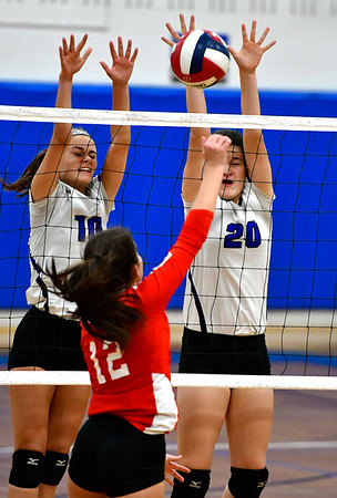 11/10/2018 Mike Orazzi   Staff Southington High School's Jenna Martin (10) and Kayli Garcia (20) during the Class LL Quarterfinal Girls Volleyball Tournament in Southington Saturday.
